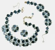 A set of Necklace, bracelet and earrings, Mitchel Maer for Christian Dior. metal coated with rhodium, synthetic sapphire, rock crystal. Early 1950s. £ 1100-1300