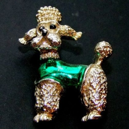 small poodle made of alloy coated by gold gilding. 1970s