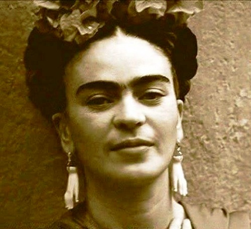 Frida Kahlo in unusual earrings in the form of hands