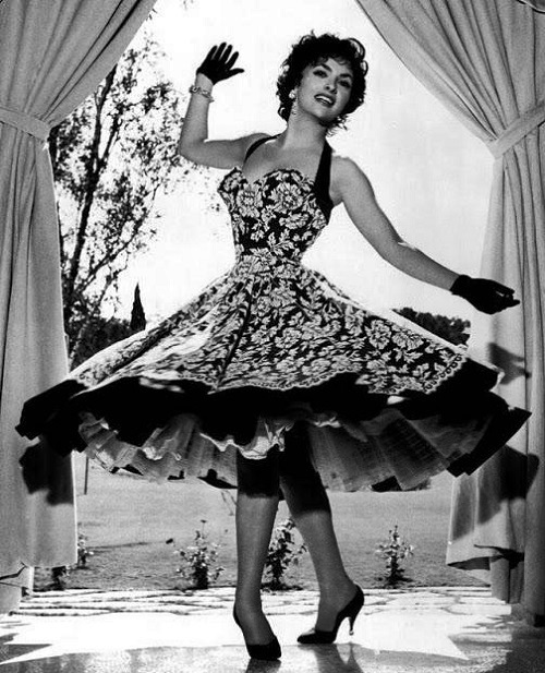 Gina Lollobrigida. Dior is quoted as saying 'I have designed flower women'