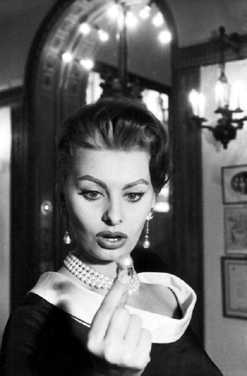 Sophia Loren is in awe of a 200 grain pearl ring at Cartier in Paris
