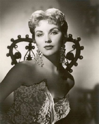 Long Pearl earrings. Debra Paget