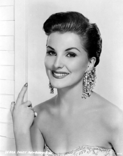 Massive pearl earrings decorate Debra Paget
