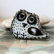 Brooch Little owl. Made in the Tiffany stained glass technique. Glass, metal, patina is a burnished silver. Kiln painted