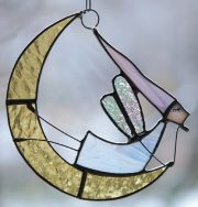 Fairy on Crescent. Small stained glass suspension. Glass, metal