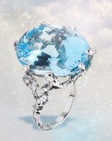 Large aquamarine with diamonds ring