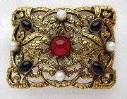 Vintage brooch. Metal bronze tone, artificial pearls, cabochons of agate and carmine colors from art glass