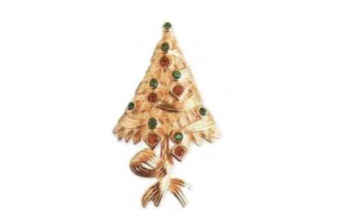 Vintage brooch made of jewelery alloy of golden tone. Decorated with Swarovski crystals. 1990s