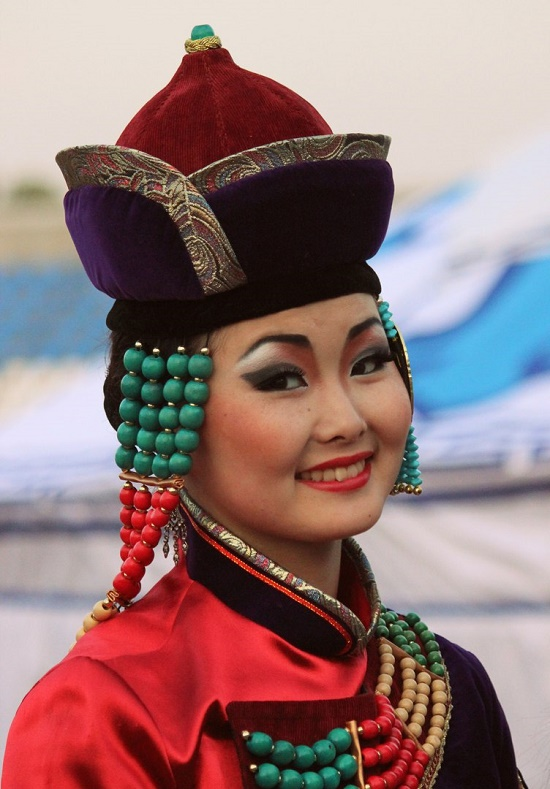 Coral jewelry decorate the national costume of a Buryat woman