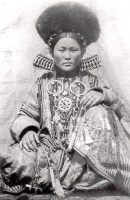 Old photo of Buryat woman in national costume, early 20th century