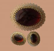 Clips and brooch. Faux amber glass stone and clear rhinestone. Gold tone metal