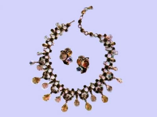 Charming Necklace and Earrings. Metal, gilding, rhinestone, drops of colored glass. 1950's. £ 750-850