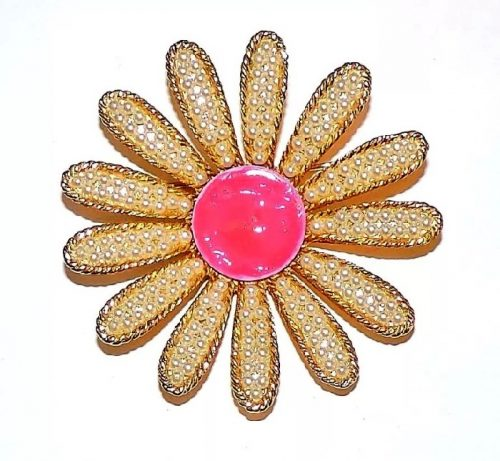 Pink and gold tone brooch