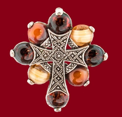 A fascinating brooch-pendant 'Celtic cross'. Made of pewter, inserts - cabochons of smalt, imitating semiprecious ornamental stones. 1950-60's