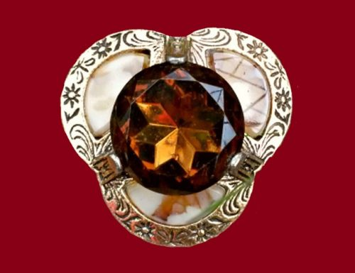 A vintage brooch with a beautiful, cognac color, a large crystal in the center. Made of an aged bronze metal with insets of smalt. Size 4.0 cm, labeled