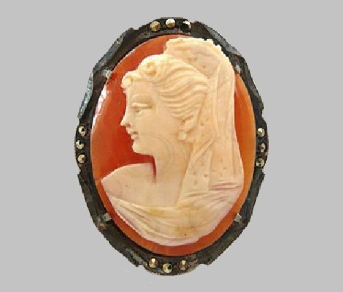 Antique cameo carved on a seashell, in a silver frame, decorated with natural marcasite