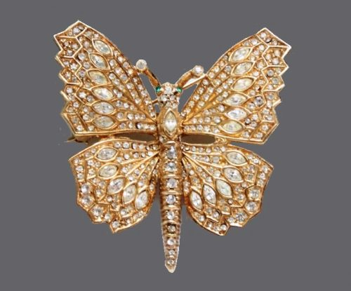 Butterfly brooch with bright crystals of various shapes, labeled Ciner. 5 x 5 cm