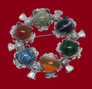 Celtic brooch decorated with multi-colored stones