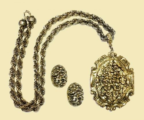 Large locket pendant necklace and matching clip earrings, vintage 1960's