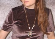 Pendants and chains adorn the area of the most important energy zones - the throat, heart and solar plexus