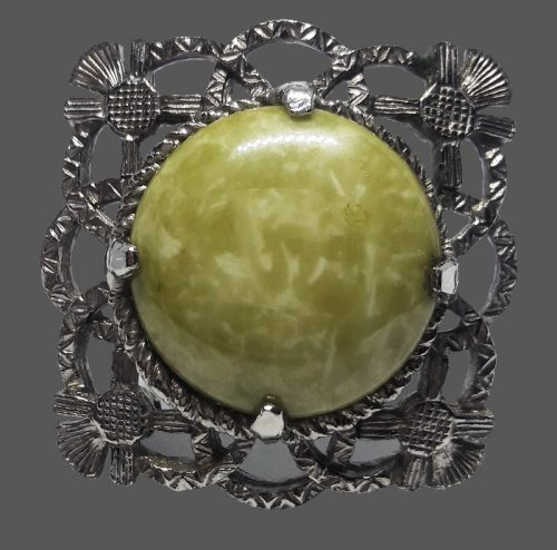 Square brooch decorated with green stone