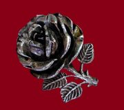Volumetric Rosette brooch. Marked, size 4 cm. Made of metal for antique silver with black