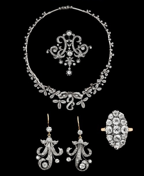 Stunning set of diamond necklace, earrings, brooch and ring. Jewellery set sold at auction