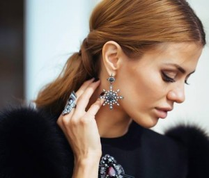 Russian celebrity Victoria Bonya wearing Bochic conquistador ring and black and white diamond earrings