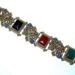 "Rectangular Cabochon Bracelet, used faux lapis, faux onyx, faux carnelian and faux jade. Marked ""ART"" with a copyright symbol on four links"