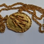 Gold tone pendant and chain