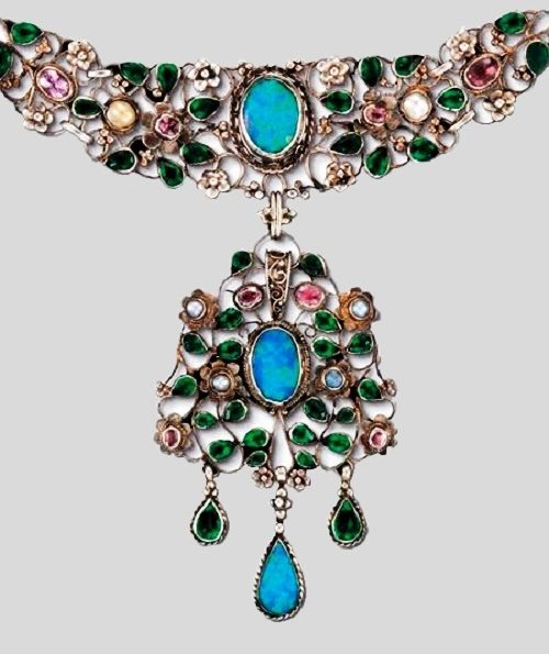 Arts and Crafts necklace with blue opal cabochons, emeralds, and pink tourmalines, made by Georgie and Arthur Gaskin in the early 20th century