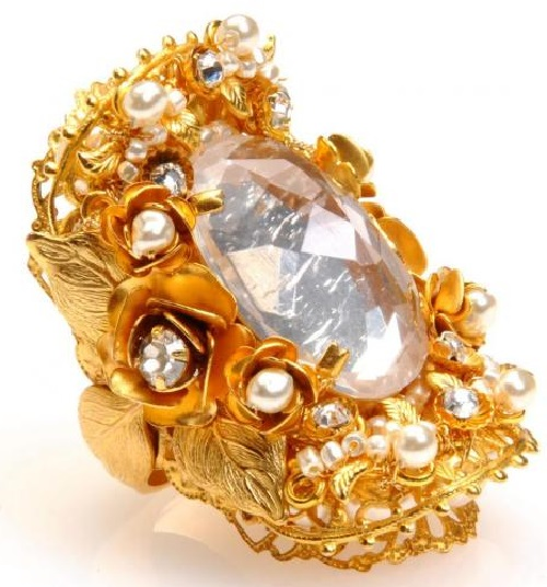 Gold tone metal and pearl brooch