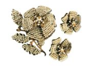 Flower brooch and earrings. 1960s. Gold-plated metal, artificial pearls, montanite, glass beads. £ 170-200