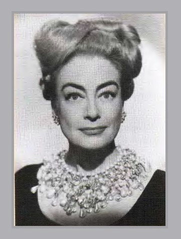 Hollywood actress Joan Crawford in a breastplate jewelry by Haskell