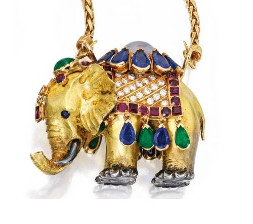 Elephant pendant necklace. 18 karat gold, silver, colored stone and diamond