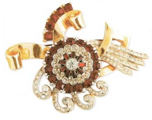 A large 25 cm brooch, gilded silver, cabochons of ruby glass, rock crystal