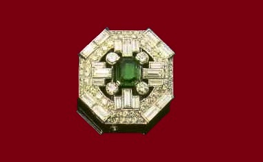 Brooch with emerald and diamonds. 1930-1935. Paris. The design is typical of the 1930's texture contrast between the radiant surfaces of diamonds