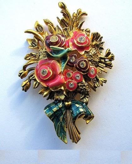 Charming bouquet with a birdie by Bob Mackie. Bright enamel, rhinestones. marked
