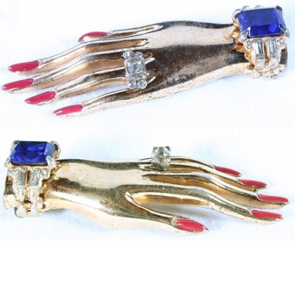 Sterling vermeil clip and earrings set in the shape of a lady's hand with rhinestone jewels and painted fingernails