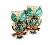 Owls. gilded silver, blue enamel, aquamarine and transparent rhinestone. 1940s 3.75 cm £ 150-170 CRIS
