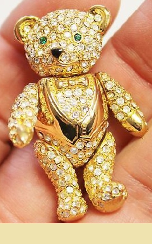Teddy bear collectible vintage brooch. The legs and head are movable, Austrian crystals, gilded