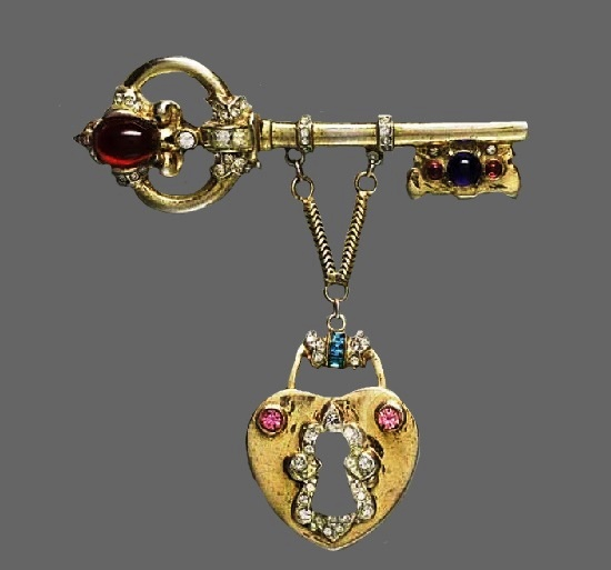 Key and lock brooch pendant. 1947. Sterling silver, gold plated, plastic, rhinestones. 7.5 cm. Designer Adolph Katz1