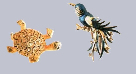 Turtle and bird brooches, 1970a £45-55