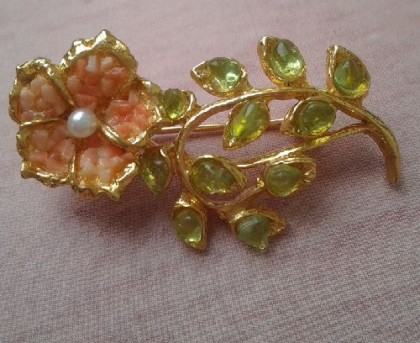 Dew-washed brooch. Jewelry alloy with gold. Five petals decorated with corals, the center of the flower – small jewel, and beryl 'pretending' leaves