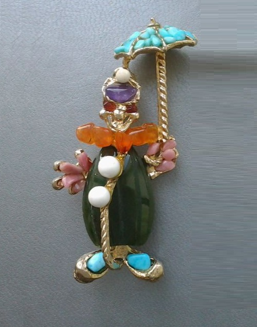 A clown walks. Jewelry alloy, coating with gold. Figure and costume of clown decorated with semiprecious stones: jade, turquoise, rhodonite, amethyst, carnelian and cacholong