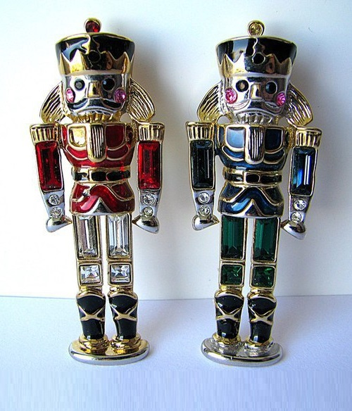 Nutcrackers by Monet with bright crystals and enamels. marked