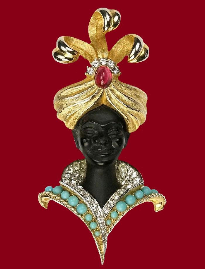 blackamoor prince vintage brooch. Gold tone jewelry alloy, rhinestones, enamel, glass cabochons