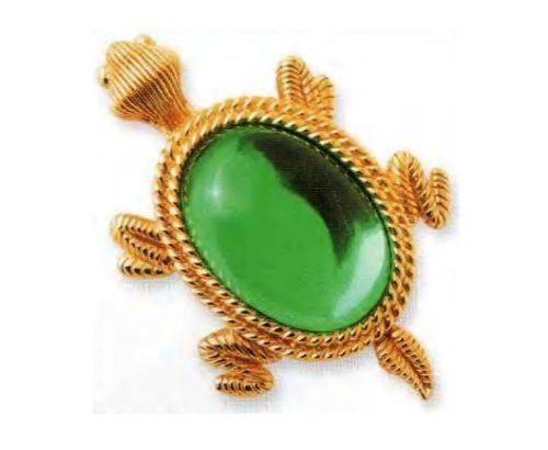 Turtle brooch. Metal, gilding, engraving, glass jade-colored cabochon. 1980s 5 cm. £ 25-30 JJ