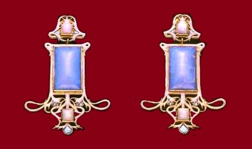 A pair of earrings with opal and enamel in the original case. 1900-1905