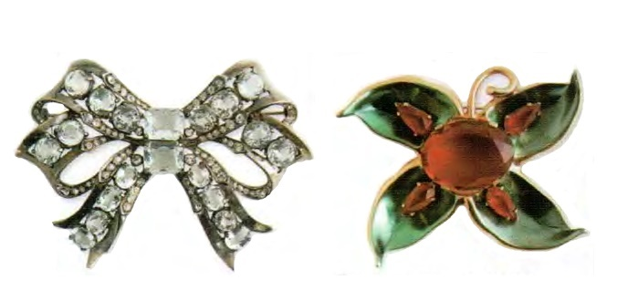 Bow brooch. Rhodium plated metal, Swarovski crystal clear crystal. Early 1940s. 9 cm. £ 165-200 ABIJ. Flower brooch. Metal, gilding, molten glass, cabochon made of Austrian crystal, ruby rhinestone. 1940. 10 cm £ 650-750 SUM